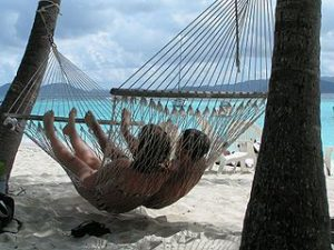 Picture of a couple relaxing in a hammock